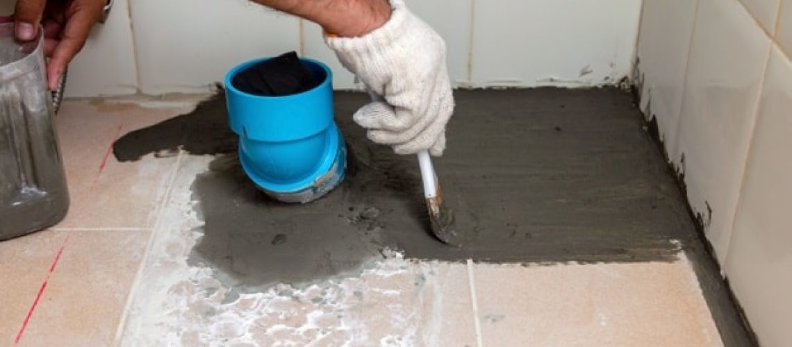 construction-workers-are-brushing-waterproofing-cement-tile-floors-bathroom_47469-648